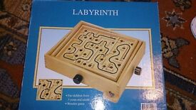 Marble labyrinth boxed game.