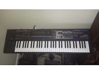 Roland Juno Gi keyboard synthesiser with recorder