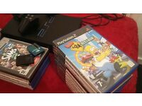 Playstation 2 (Ideal for any child) with 1 controller, 2 memory cards, 25 games & original console