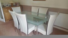 Glass topped dining table and six chairs