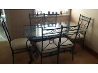 Metal dinning table with glass top with six chairs