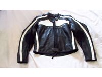 Ladies size 10 armoured two piece top grade leathers excellent condition.