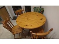 Old style wooden country table with 4 chairs can deliver