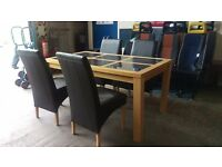 Oak large dining table and 4 black leather chairs