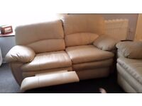 Twin cream leather recliner sofas