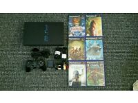 Playstation 2 console with 6 good games
