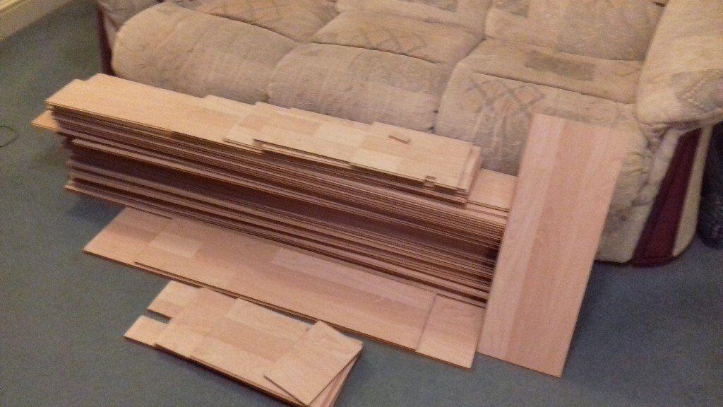 Light wood colour laminate flooring (used).