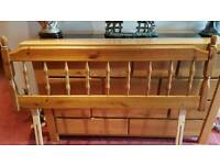 A pair of pine double bed headboards