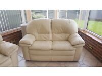 Two 2 seater cream leather sofas excellent condition