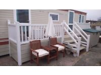 2 BEDROOM, 6 BERTH 30' X 10' STATIC CARAVAN WITH DECKING & SKIRTING SITED IN CAISTER ON SEA