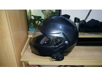 Hjc is max 2 flip up helmet with bluetooth headset.