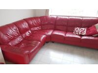 6-seater, red leather corner sofa.