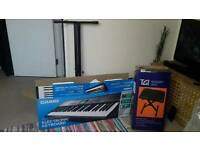 BRAND NEW - Electric Keyboard with accessories