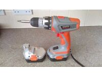 Cordless drill with hammer action, various speeds, spirit level attachment, and spotlight, 18v.