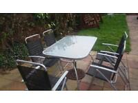 5 garden chairs with table