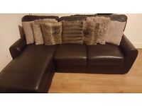 Black leather corner sofa and armchair