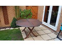 Big wooden garden patio table