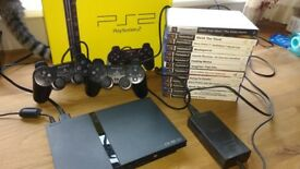 Boxed Sony PS2 Console plus two controllers plus remote plus over 12 games