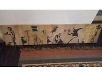 Picture with various Banksy prints - 168cm x 38cm