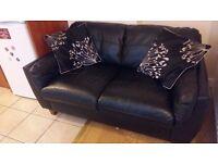 2 small black sofas plus cushions £120