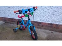 Childrens 12inch micky mouse bike with stabilisers. Good condition