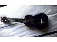 Purple ukulele, unused with case.