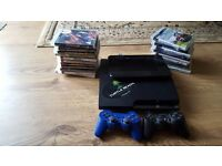Playstation 3 approx 20 games. 2 controllers. Cables.