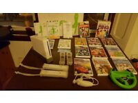Wii console + Wii fit board + bundle of games + some extras £80