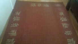 Wool/jute blend rug (Rust coloured) - 120x170cm - asian characters border