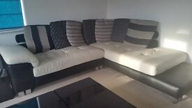 Black and white leather and fabric corner sofa