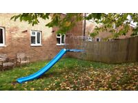 Climbing frame, slide and trapeze swing