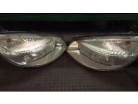 For sale Pair Renault scenic 06 plate headlights good working order and condition