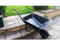 Black metal wheelbarrow