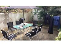 Garden table, 6 chairs and umbrella