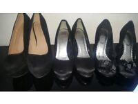 womans black high heel shoes