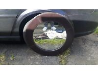 Black circle leather surrounded mirror