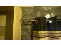 Curtain pole. Black and extends to 2m.