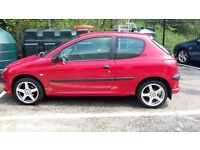Peugeot 206 red 3 door 1.2 cheap trade in alloys electric Windows 2 owners.