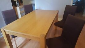 Solid oak dining room table and 4 chairs with removable washable covers