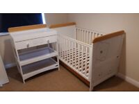 White cot bed and changing table with teddy bear design