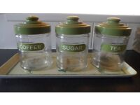 Tea coffee sugar containers.