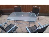 Garden table and 4 chairs great condition