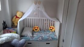 Ikea babys bed with draws, mattress and canopy.
