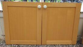 Solid birch type wood cupboard doors and draws.