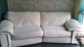 4 seeter cream sofa.