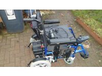 Enigma power wheelchair/scooter