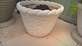 sensible offers on a pair of stone planters.