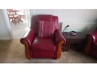 Red leather three piece suite, two seater sofa and two chairs