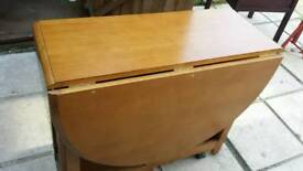 Round drop leaf table with drawer and door in end