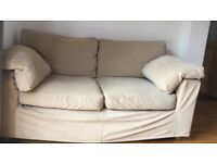 Two seater cream next sofa